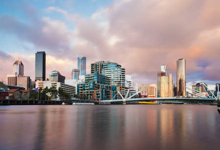 Cityspace of Dockland in Melbourne at sunset, long expsure, blurring clouds and smooth water