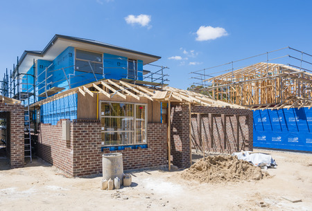 housebuilding: Melbourne, Australia - Nov 15, 2015: Houses under construction in a suburb in Melbourne, Australia Editorial