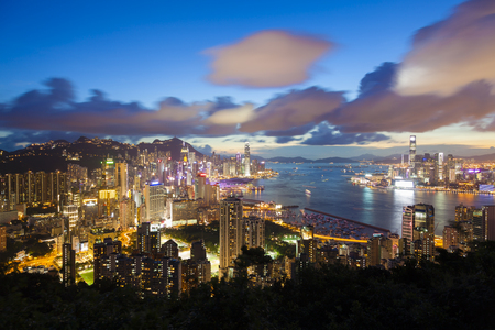 finanical: Modern buildings around Victoria Harbour in Hong Kong at night