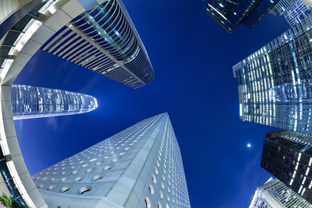 low glass: Syscrapers in Hong Kong in daytime, blue tone, fisheye view
