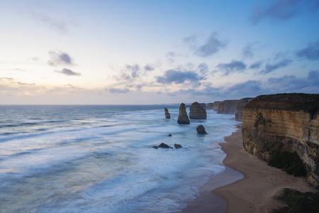 rocks water: Twelve Apostles in Australia at sunset, long exposure