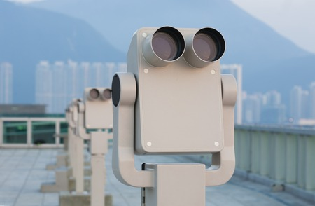 lookout: Row of sightseeing tourist binoculars at a tourist lookout Stock Photo
