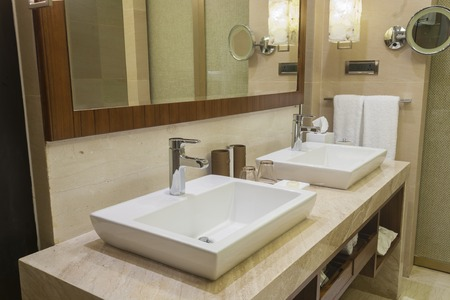 Luxurious hotel bathroom with two vanity basins Stock Photo