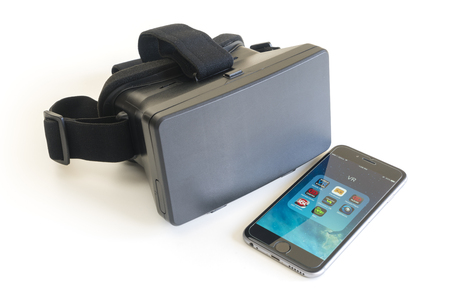 Melbourne, Australia - Dec 9, 2015: View of a virtual reality headset and an iPhone installed with some VR apps Editorial