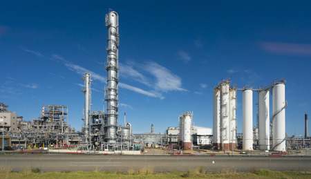 distillation: Factionating columns and distillation towers in a oil refinery