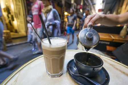 Enjoying coffee and tea at a cafe in a laneway, shallow depth of view