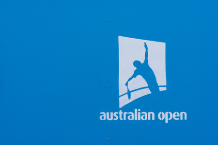 annually: Melbourne, Australia - Jan 7, 2016: Australian Open logo on a blue wall. The Australian Open is a major tennis tournament held annually in Melbourne, Australia.