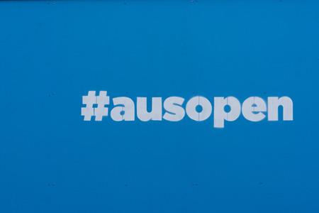 tweets: Melbourne, Australia - Jan 7, 2016: Ausopen Australian Open hashtag on a blue wall. The Australian Open is a major tennis tournament held annually in Melbourne, Australia.