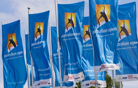 australian flag: Melbourne, Australia - Jan 7, 2016: Flags with Australian Open logos waving in the wind. The Australian Open is a major tennis tournament held annually in Melbourne, Australia.