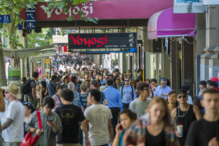 busy person: Melbourne, Australia - Dec 16, 2015: People walking along a busy street in downtown Melbourne, Australia