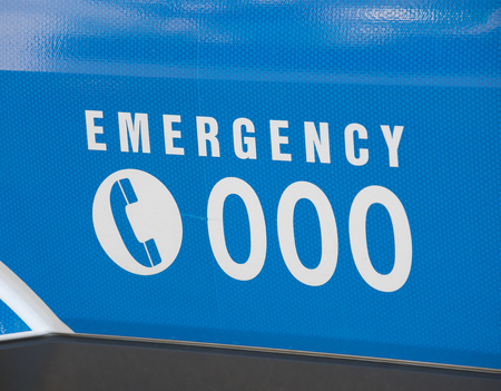 emergency number: Emergency number 000 in Australia on an ambulance