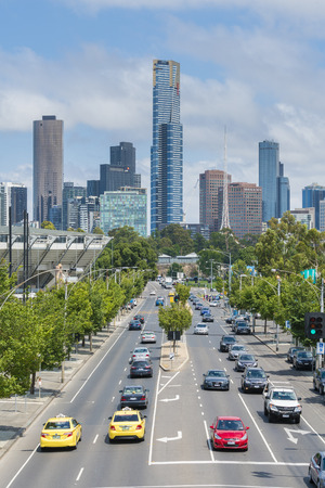 city road: Melbourne, Australia - Jan 7, 2016: View of modern buildings and traffic of a busy road in Melbourne CBD Editorial