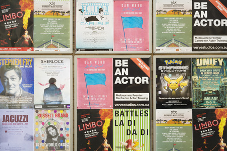 Melbourne, Australia - Oct 27, 2015: Advertising posters of various cultural events in Melbourne. It is a city with many cultural events and festivals throughout the year.