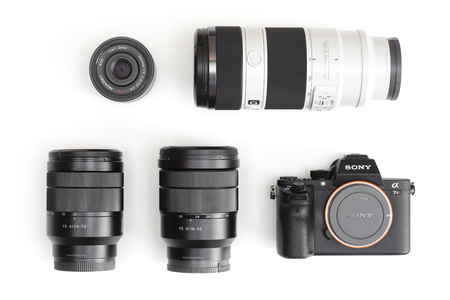 sony: Melbourne, Australia - Feb 10, 2016: Flat lay photo of Sony A7R II  mirrorless camera and E-mount lenses. The camera features the worlds first 35mm backside illumination CMOS sensor. Editorial