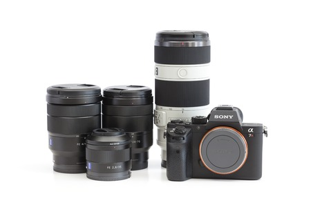 sony: Melbourne, Australia - Feb 10, 2016: Sony A7R II  mirrorless camera and E-mount lenses. The camera features the worlds first 35mm backside illumination CMOS sensor.