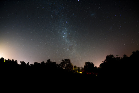 stars night: Mllky way in the southern hemisphere with subtle light from a campsite