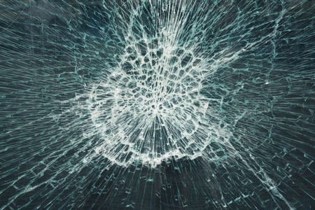Close-up view of a broken glass window Stock Photo