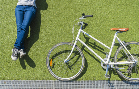 top down: Top down view of vintage bike and cyclist on lawn