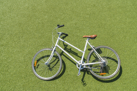 Top down view of vintage bike on lawn