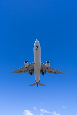 jet plane: Jet passenger airplane approaching an airport for landing, view from below