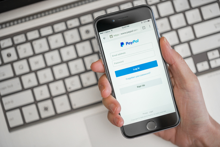 paypal: Melbourne, Australia - May 10, 2016: Using PayPal on iPhone. PayPal is a worldwide online payment system and one of the most popular ways of making payment on the Internet.