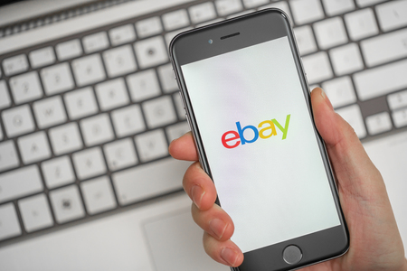 ebay: Melbourne, Australia - May 10, 2016: Using eBay app on iphone for online shopping. eBay is an online auction and shopping website. Editorial