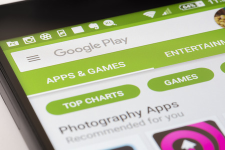 google play: Melbourne, Australia - May 17, 2016: Browsing the Google Play Store on Android smartphone. It is an app store for the Android OS, allowing users to download app, music, movies and TV shows