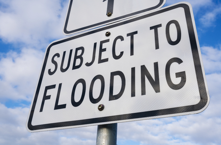 flood area sign: Close-up view of subject to flooding sign