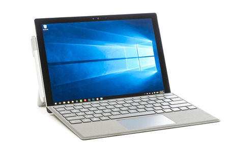 pro: Melbourne, Australia - Jun 12, 2016: Microsoft Surface Pro 4 isolated on white background. It is a 2 in 1 detachable PC produced by Microsoft.