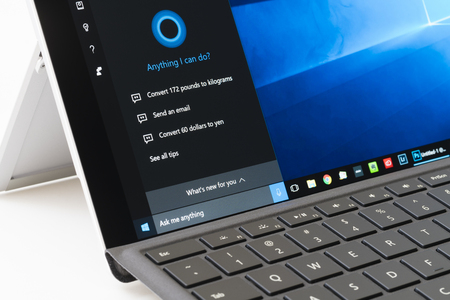 on the surface: Melbourne, Australia - Jun 13, 2016: Using Cortana on Surface Pro 4. It is an intelligent personal assistant created by Microsoft for Windows 10. Editorial