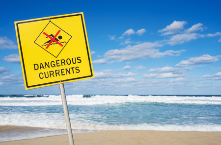 currents: Dangerous currents sign at Bondi Beach in Sydney, Australia