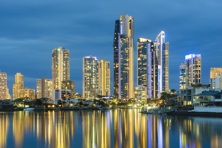 waterfront property: View of cityscape of Gold Coast, Australia with reflection at twilight