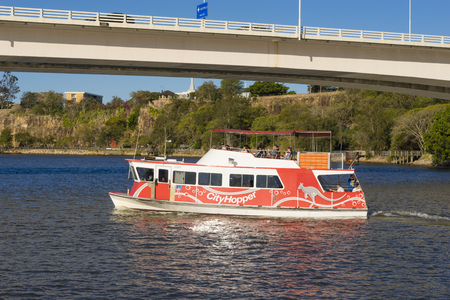 onboard: Brisbane, Australia - September 23, 2016: People onboard the free CityHopper ferry in Brisbane during daytime. The ferry service is free and runs along the Brisbane River.