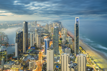 australia: Aerial view of modern buildings with light trail at riverside at Gold Coast, Australia during sunset