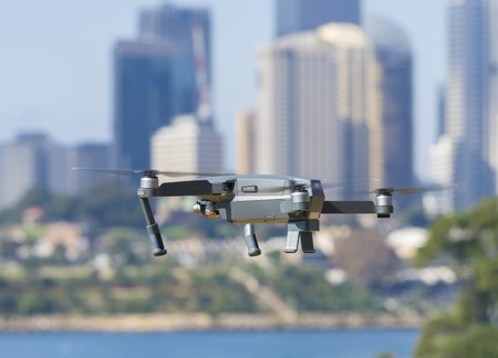 Sydney, Australia - May 11, 2017: A DJI Mavic Pro drone flying near city centre. Many countries have implemented laws to regulate the use of drones to ensure public safety. Editorial