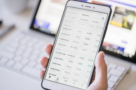 Checking commodity prices on a smartphone Redakční