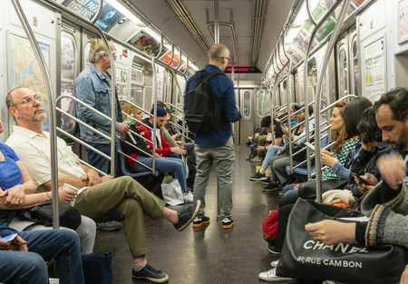 Commuters travelling in a subway train in New York City 新闻类图片
