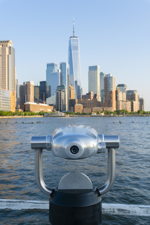 Tower telescope facing Manhattan skyline in New York City