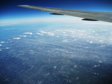 aluminum airplane: Airplane wing, aerial as plane approaches New York City