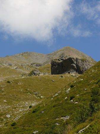 collet: Old cave dweller sheep barn - sheepfold in pre Alps pasture landscape, near refugee Jean Collet, Belledonne, France