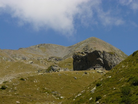 cave dweller: Old cave dweller sheep barn - sheepfold in pre Alps pasture landscape, near refugee Jean Collet, Belledonne, France