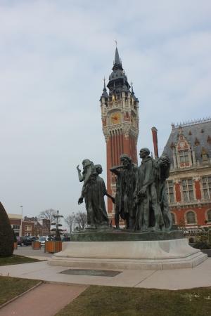 calais: City hall of Calais taken in the Calais of France and Les 6 Bourgeois de Calais
