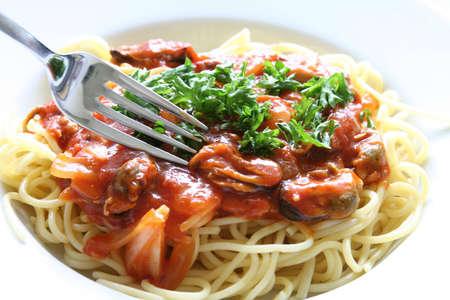 european cuisine: Plate of spaghetti with tomato sauce. Stock Photo
