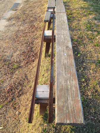 almost: An almost broken wooden bench at a ballpark