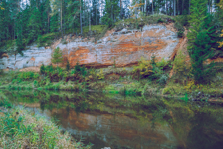 cascade: Rock at the river Salaca in Latvia. 2014 Sandstone cliffs on the river shore in the Gaujas National Park.
