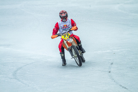 Latvia, Raiskums, Winter motocross, Driver with motorcycle, race, lake. 2015 Editorial