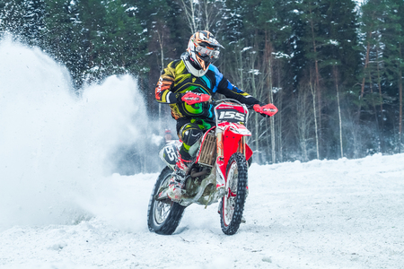 Latvia, Raiskums, Winter motocross, Driver with motorcycle, race. 2013 Editorial
