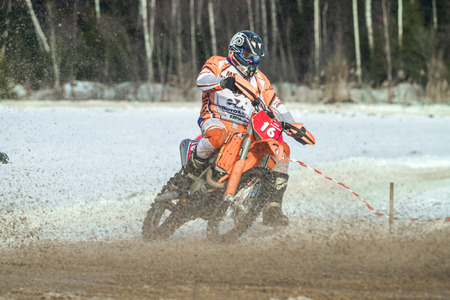 Latvia, Raiskums, Winter motocross, Driver with motorcycle, race. 2013 Editorial