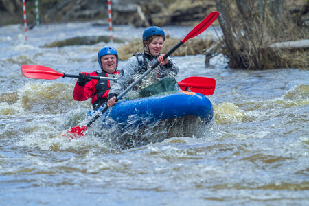 Rafting race in spring. River amata, Latvia. Peoples and boat, water and speed. 2012.