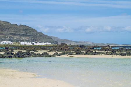 Blue Lanzerote water, summer sun and beach.